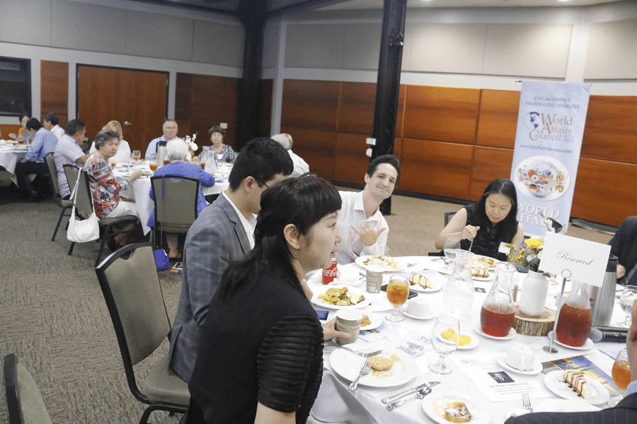 members and guests discussing at a luncheon