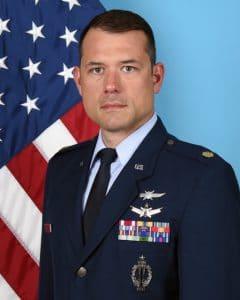 image of Major Alex Ruiz in front of flad